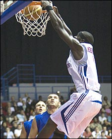 Pops Mensah-Bonsu slams down a dunk in Birmingham