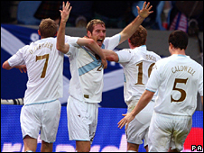 Kirk Broadfoot celebrates his first half goal in Reykjavik