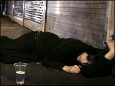 Drunk man lying in street (generic)