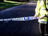 Garda officer putting out police tape