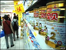 Chinese shoppers check out milk formula on sale at a supermarket in Kunming, Yunnan province, on Thursday