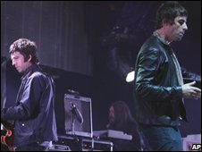 Noel and Liam Gallagher (r) of Oasis