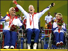Nigel Murray, Dan Bentley and Zoe Robinson celebrate winning gold