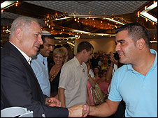 Likud leader Binyamin Netanyahu shakes hands with supporter Kobi Torgman