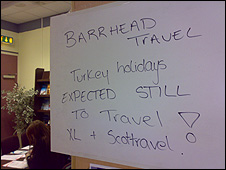 Sign telling passengers that flights are still expected to depart