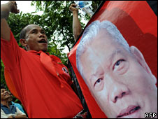 A protester holds a banner of former leader Samak Sundaravej on 12 September 2008