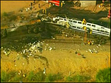 Derailed coaches at the site of the collision