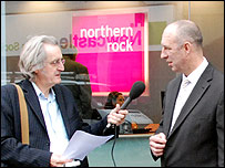 Paul Lewis with Chris Jary, director, Action for Debt, outside a Northern Rock branch in Newcastle