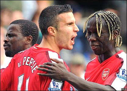 Emmanuel Eboue, Robin Van Persie, and Bacary Sagna of Arsenal