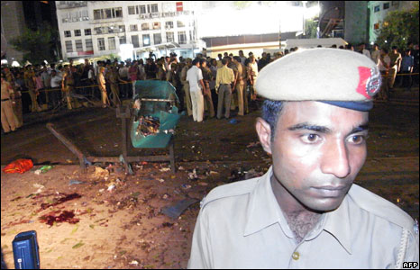 A policeman stands guard at a site of a blast in Delhi