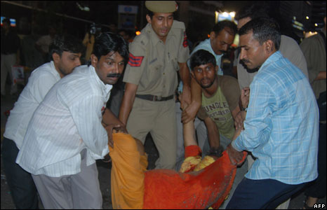 A victim of the blast is carried away in Delhi