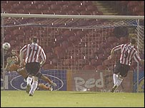 Sammy Morrow scores Derry's equaliser from the penalty spot