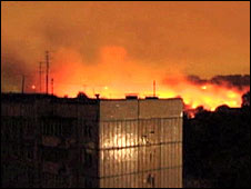A still from Russian TV shows flames at the crash site early on 14 September