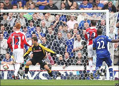 Victor Anichebe (out of shot) scores