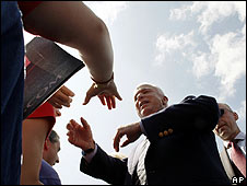 John McCain greets supporters at a campaign rally in Fairfax, Virginia, on 10 September