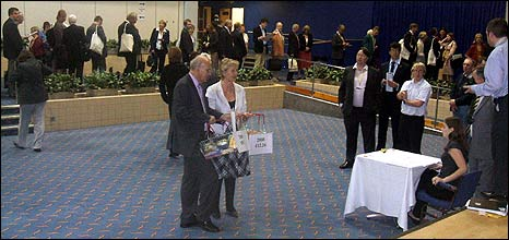Vince Cable and queue of delegates
