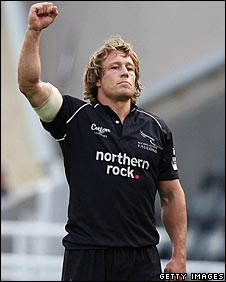 Jonny Wilkinson salutes his last-minute drop-goal which denied Northampton a losing bonus point
