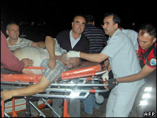 Medics assist a passenger from a ferry in Turkey
