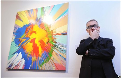 Damien Hirst with a painting