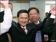 Somchai Wongsawat celebrates after being selected as the Thai ruling party's candidate for PM on Monday