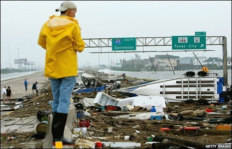 A man surveys a field of debris left by Ike on 13 September 2008 in Galveston, Texas