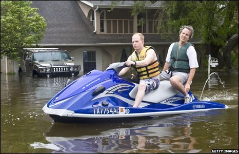 Two householders use a jet ski to get around their neighbourhood on 13 September 2008 in Nassau Bay, Texas