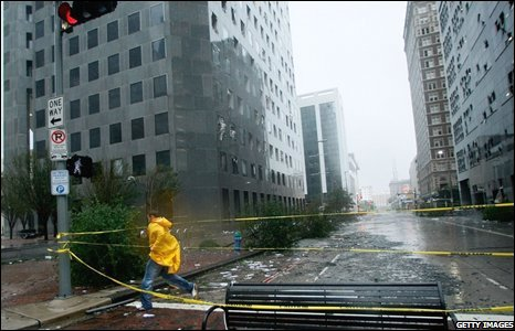 In Houston, Texas, on 13 September 2008 a man walks by the JP Morgan Chase Tower which had many windows blown by Hurricane Ike