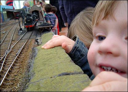 Children admiring model trains