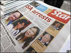 An English-language Malaysian newspaper headlined with arrests on Saturday