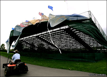 Flags swirl on a temporary grandstand