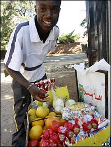 Man selling goods by the roadside
