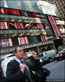 People walk past the headquarters of the investment bank, Lehman Brothers in Manhattan