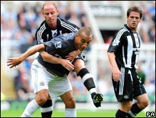 Nick Butt of Newcastle tangles with Craig Fagan of Hull as Michael Owen watches