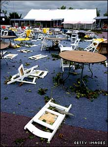 Chairs in the tented village are strewn around by high winds