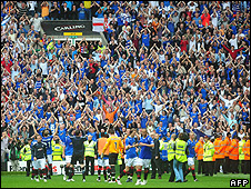 Rangers fans celebrate after their team's victory over Celtic