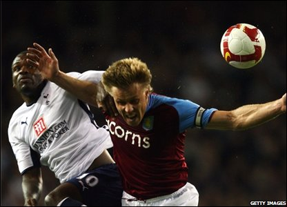 Darren Bent of Spurs and Martin Laursen of Villa
