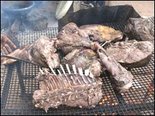 Warthog meat being cooked in Nigeria