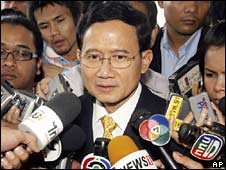 Prime ministerial nominee Somchai Wongsawat surrounded by reporters in Bangkok on Tuesday