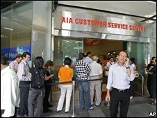 Worried AIG customers queue up in Singapore