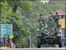 Soldiers patrol a street in Vavuniya, about 200 kilometers (125 miles) northeast of Colombo, Sri Lanka, Tuesday, Sept. 9, 2008.