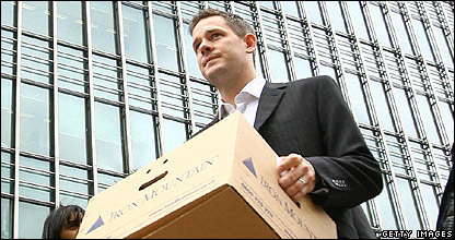 Worker with box of possessions