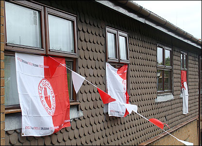 Tyrone flags hanging from windows