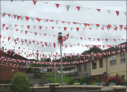 Red and white bunting across street