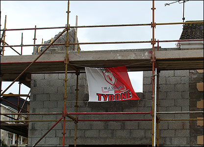 Tyrone flag hanging from scaffolding