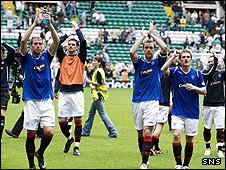 Rangers players applaud their fans at Celtic Park