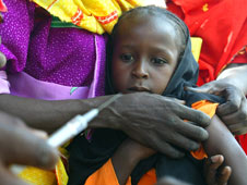 A young girl being vaccinated against measels and polio