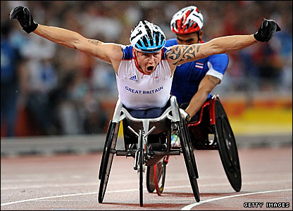 Britain's David Weir celebrates winning gold