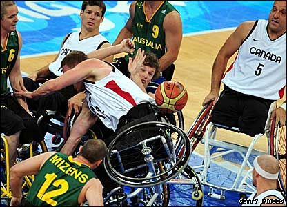 Australia and Canada wheelchair basketball players tussle for the ball