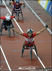 Chantal Petitclerc celebrates winning the T54 1500m