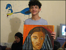 Saoud with a portrait of his sister